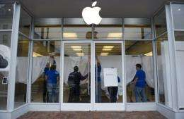 Steve Jobs was honored online and off Wednesday as the company's shops closed temporarily for workers to mourn his loss