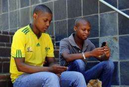 Students at Witwatersrand University in Johannesburg use their mobile phones