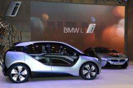 The BMW i3 concept (L) and the BMW i8 concept (R) are on display at the 42nd Tokyo Motor show