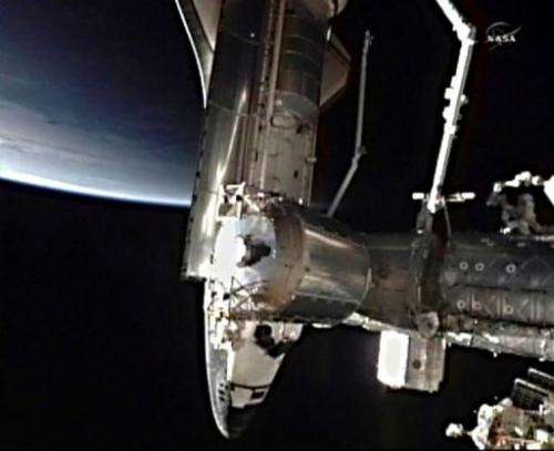 This July 10 NASA TV video image shows the space shuttle Atlantis docking with the International Space Station (ISS)