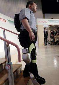Toyota shows machines to help sick, elderly move (AP)