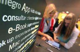 Visitors try out ebook devices at the Frankfurt Book Fair in Germany