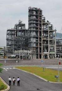 Visitors walk towards the Neste Oil NExtBTL renewable diesel plant
