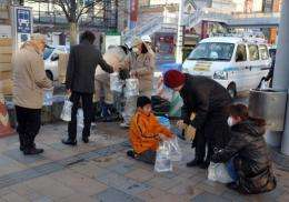 Workers from Koriyama distribute emergency waterbags to citizens in downtown Koriyama