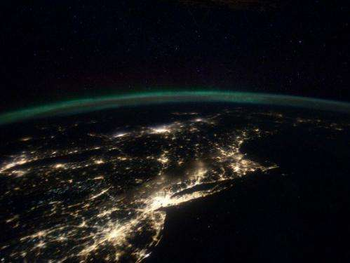 A continent ablaze in auroral and manmade light