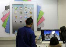 Customers browse products at an Apple store in Beijing