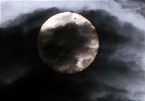 Eyes turn skyward as Venus travels across the sun