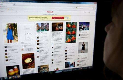 A woman looks at the internet site Pinterest.com