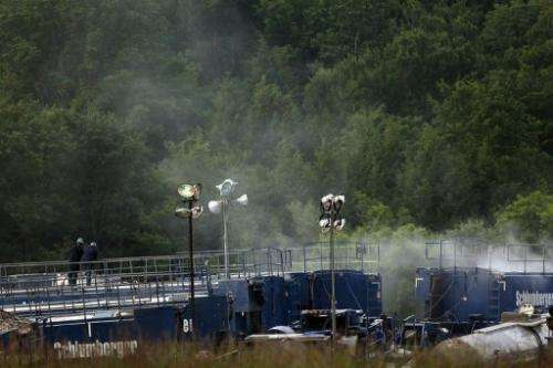 Men work on a natural gas valve at a hydraulic fracturing site in June 2012 in South Montrose, Pennsylvania