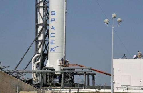 SpaceX's Falcon 9 rocket, carrying the unmanned Dragon capsule, at Cape Canaveral Air Force Station