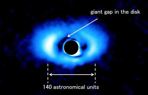 Discovery of a giant gap in the disk of a sun-like star may indicate multiple planets