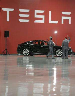 First Tesla electric sedans hit the road