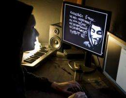 A masked hacker, part of the Anonymous group, pictured in January