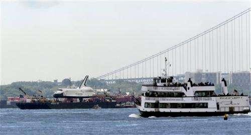 Space shuttle Enterprise floats to Manhattan home