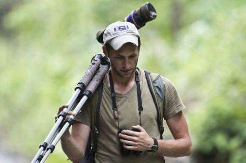 A birdwatcher takes part in the Birding Rally Challenge near the Machu Picchu sanctuary in Cuzco on December 5, 2012