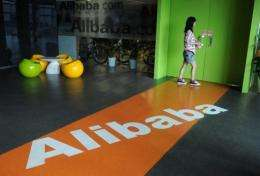 A Chinese Alibaba employee walks through a communal space at the company headquarters