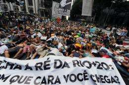Activists lie in the street during a demonstration against the forest code and the Belo Monte Hydroelectric plant