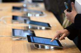 A customer uses a tablet during the inauguration of a new Apple store in Strasbourg, France, on September 15