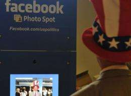 A delegate poses in the Facebook photo booth during Republican National Convention