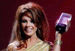 Adult film actress Kirsten Price accepts an award at a ceremony in Las Vegas