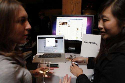 A Foodspotting representative demonstrates the company's app for Facebook