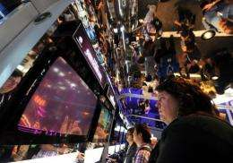 A gamer plays at video games during the Electronic Entertainment Expo