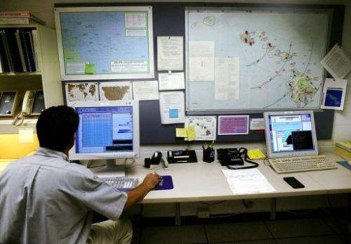 A geophysicist at the National Weather Service Pacific Tsunami Warning Center, monitors computer tracking systems