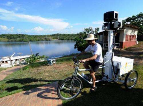 A Google team member rides a Trike with a 360-degree camera system on it, to record the