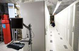 A man squats inside the Pionen high-security computer storage facility