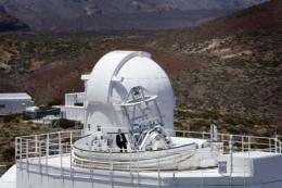 A man stands atop the German Solar Telescope GREGOR