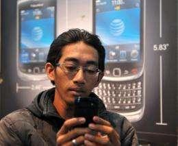 A man uses his Blackberry smartphone in Jakarta last week
