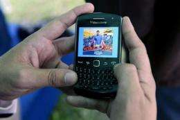 A man uses the new application for mobile phones of Venezuelan opposition candidate, Henrique Capriles Radonsk