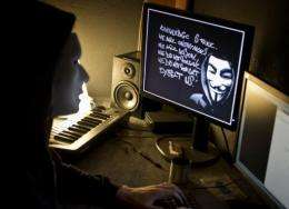 An Anonymous hacker is pictured in Lyon, France