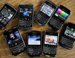 An assortment of Blackberry smartphomes seen at a restaurant in Jakarta
