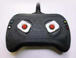 A new direction for game controllers: Prototypes tug at thumb tips to enhance video gaming