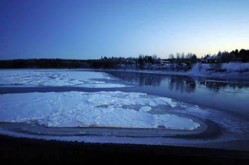 A partially frozen river is pictured at dawn near Kittilae in Lapland, Finland, in 2008