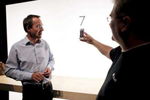 Apple employees demonstrate Facetime, a video chat application
