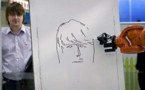 A robot draws a portrait of a visitor at the world's biggest high-tech fair, the CeBIT, in Hanover