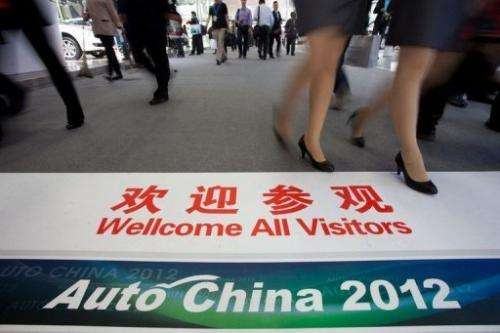 A sign welcomes visitors to the Auto China car show in Beijing
