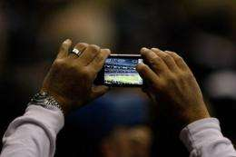 A survey shows that 60% of mobile owners will check or use their devices during the Super Bowl