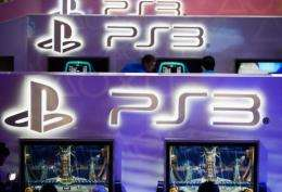 Attendees play new video games at the Sony Playstation booth during the E3 gaming conference in Los Angeles