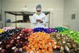 A worker inspects chocolates at a factory in Mecicilandia