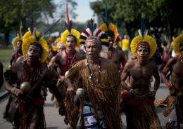Brazilian Pataxo natives sing at the People's Summit in Rio de Janeiro