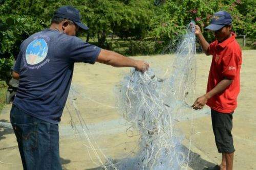 Cambodian river guards display confiscated gill nets at their office along the Mekong river on December 6, 2012