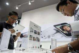 China faces conflict of law, business in iPad row (AP)