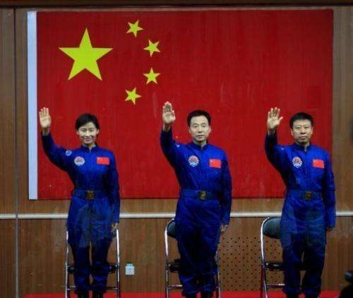 Chinese first woman astronaut Liu Yang together with her two male colleagues, Jing Haipeng (centre) and Liu Wang