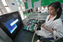 Chinese workers test the circuit boards at a factory in Mianyang, southwest China in April