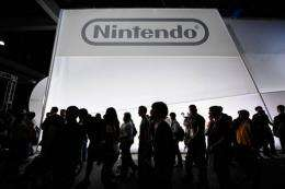 Crowds line up to view the new Nintendo game console Wii U in 2011