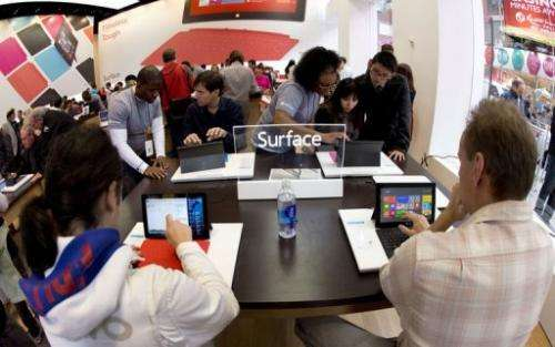 Customers get a look at tablets at Microsoft's pop-up store in New York