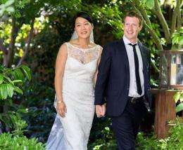 Day after historic IPO, Facebook's Zuckerberg weds (AP)